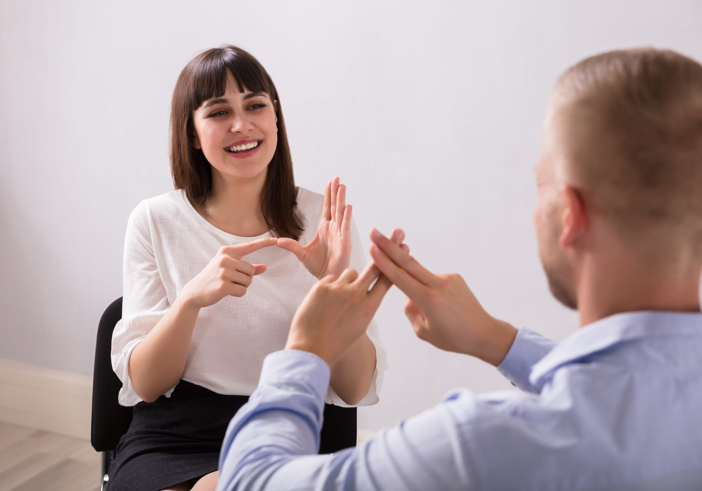 Young Woman And Man Talking With Sign Language